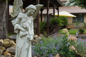 statue and flowers in courtyard
